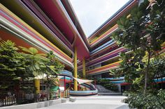 'The new extension to the existing Nanyang Primary School and Kindergarten in Singapore is designed around a large internalised valley, open to the sky but f...
