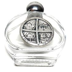It's a fabulous strong glass bottle, filled with blessed water directly from the Vatican. Use it for your own protection or for spiritual help, but do not drink it! On this bottle there is a silver oxidized medal with the four Basilicas of Rome image on it.