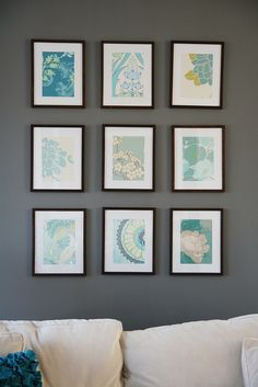 I've been working on making an art wall in the living room. I've been planning this out for months. I wanted to have it all very symmetrical and flowery and aqua-y. And it is a big wall…