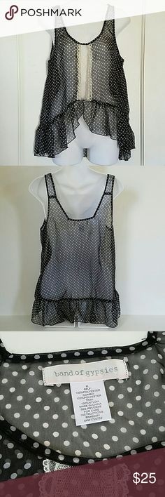 Band of Gypsies bohemian lace tank top sz Med Band of Gypsies bohemian tank top. Excellent used condition. No holes, stains or wash wear.  - navy blue polka dot tank top - super flowy with a bohemian look - lace panel down the front - see through material - 100% polyester - machine washable - size Medium  I love offers! Please feel free to negotiate price through the offer button. Band of Gypsies Tops Tank Tops
