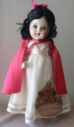 """Madame Alexander Snow White Doll, 1937  -  This beautiful, all original Snow White doll was produced by Madame Alexander in 1937 to coincide with the release of the Walt Disney film.   The landmark film was the top-grossing box office draw ever until """"Gone with the Wind"""" broke its record in the 1939/40 season.  -   """"Snow White and the Seven Dwarfs"""" was the inspiration for MGM to produce its own fantasy picture, """"The Wizard of Oz"""" and paved the way for countless  animated films afterwards."""