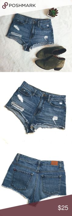 """BDG cheeky high waisted distressed jean shorts Dare to bare! These are very cheeky high waisted distressed short shorts from BDG.  5 pockets, logo bronze buttons   Condition: distressed, great condition overall Size: 25W or XS Waist: 14"""" Inseam: 1"""" Length: 9"""" on sides  🚫trade  🏷lowest price or bundle & take 20% off  Lots of XS and small listings available for bundling, check out the rest of my closet! BDG Shorts Jean Shorts"""