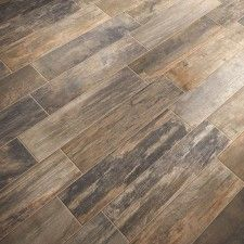 Perfect compromise. I want hard wood. Mark wants tile. This is tile that looks like hardwood.