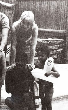 Playtime: May Britt, Sammy Davis Jr with life saving float, and Mark enjoying playtime at Lake Tahoe. His father would goof around with the float to make his children laugh