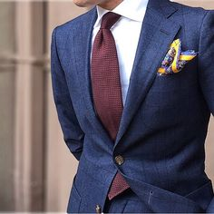 A navy check suit and a white dress shirt will showcase your sartorial self. Shop this look on Lookastic: https://lookastic.com/men/looks/navy-suit-white-dress-shirt-burgundy-tie/21225 — White Dress Shirt — Burgundy Tie — Yellow Print Pocket Square — Navy Check Suit