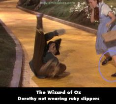 Movie Mistake: Dorothy wasn't always wearing her red slippers on the yellow brick road #Oops
