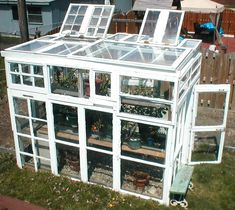 Rain Barrels, Chicken Coops, and Solar Panels Greenhouse from old windows. Diy Greenhouse Plans, Window Greenhouse, Backyard Greenhouse, Small Greenhouse, Homemade Greenhouse, Pallet Greenhouse, Miniature Greenhouse, Greenhouse Growing, Greenhouse Wedding