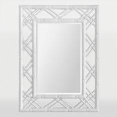 Ce cadre en faux bambou est fini en blanc éblouissant et entoure un miroir à biseau rectangulaire / This faux bamboo frame is finished in a dazzling white and surounds a rectangular beveled mirror