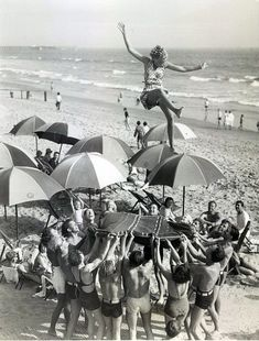 Vintage photography 1930s: 1933 - the illusion makes it seem as if she is standing on one of the umbrellas