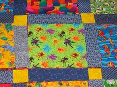 Detail of quilt combining Shweshwe indigo and bright prints.