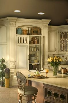Beautiful French Country Kitchen. I love the shelf above the cabinet for displaying accessories.