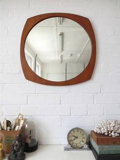 An elegant Modernist Danish teak wall mirror . Would look great in Contemporary setting. Item Specifics Height: 56.5cm (approx 22.00) Width: