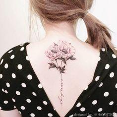 Peony calligraphy tattoo on back by Handitrip