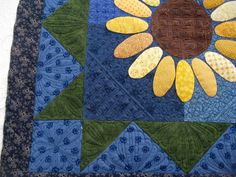 This is a quilt pieced by Wendy of Las Vegas. I had a lot of fun with this quilt!     Wendy wanted her sunflowers to stand out, so I did a ...
