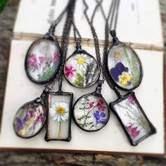 MARIAELA jewelry preserves flowers and other bits of nature in glass pendants using the Tiffany lamp method. I've been trying to do something like this for ages, never looked as good as this