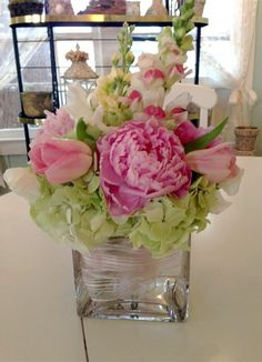 Pink peonies, apple blossoms, snapdragons, pink tulips and green hydrangeas for…