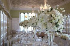 billowing clouds of Hydrangea and Roses with touches of sweetpeas and foliage Table Centerpieces, Centrepieces, Table Decorations, Bury St Edmunds, Tudor Rose, Tall Vases, Hydrangea, Glass Vase, Chandelier