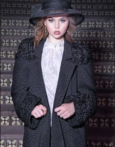 Our Modern Raglan Coat in Chrysanthemum Brocade with French Lace Netting accent. This sophisticated coat is a statement in itself!
