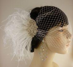 Rhinestone Bridal Feather Fascinator, White Feather Fascinator, Bridal Headpiece, Rhinestone Hair clip, Wedding Veil - Hollywood Style. $78.00, via Etsy.