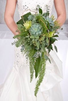 Succulent Cascading Bouquet ... a unique bouquet for a unique bride! Amazing greens, ferns, leaves, curly willow and green fugi mums. Amazing movement! By Jenny Thomasson AIFD of Stems Florist - St. Louis, MO www.stems4weddings.com #succulents #cascade #bouquet