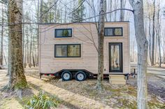 A 20' craftsman tiny house featuring pine siding with cedar trim on the exterior and white poplar shiplap walls with walnut trim throughout the interior.