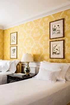 Sweet guest room with yellow wallpaper