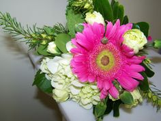 This Bridesmaid Bouquet includes Hot Pink Gerbera Daisies, Mini Green Hydrangea and Miniature White Carnations, Hot Pink Baronia Heather.  Designed by Colonial Florist, Gordonsville, VA.