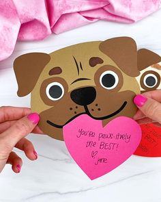 This puppy Valentine craft is a fun activity for kids to make this Valentine's Day! Download the free printable template on the blog and make it with the kids so they can give it to someone special! Easy Toddler Crafts, Frog Crafts, Valentine's Day Crafts For Kids, Fathers Day Crafts, Craft Activities For Kids, Puppy Valentines, Valentines Art, Valentine's Day Paper Crafts, Craft Instructions For Kids