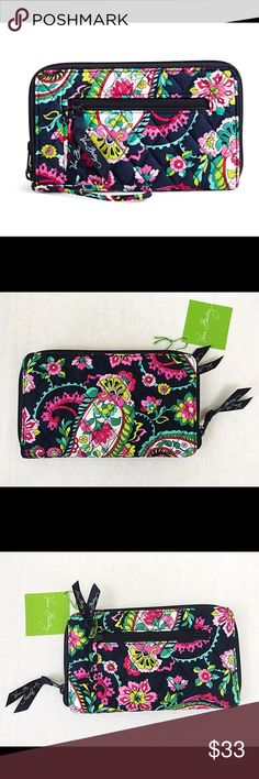 Vera Bradley Petal Paisley Zip around Wallet A quilted texture highlights the minimalist profile of this wristlet. The versatile compartments secure your items, while a removable strap offers multiple carrying options.   8.25'' W x 4.75'' H x 0.75'' D 6'' strap drop Cotton Lined Zip closure Two compartments Interior: one coin pocket, two bill pockets, one pen holder, one ID card window and 10 card slots Removable wristlet strap Vera Bradley Bags Wallets