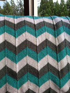 Chevrons are everywhere and here's a pattern for a sportweight yarn version of your favorite blanket that Grandma knit when you were young!