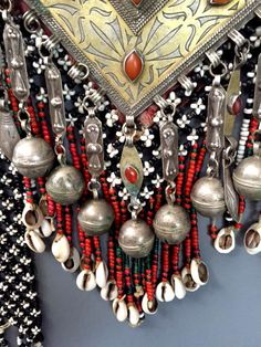 Detail of original Tekke pendant with white heart beads and cowrie shell tassels. (info@singkiang.com)