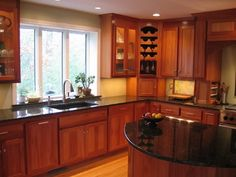Color of existing natural cherry cabinets and black granite