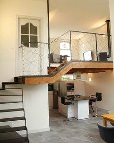 Studio Kustlijn Architecten - Dijkwoning Rotterdam Stalen trap. Houten balken. Vide. Keuken eiland. Balustrade met touw diagonaal