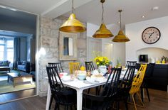 Contemporary Dining Room with Yellow Pendant Lights