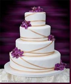cakes effortless elegance this wedding cake is decorated with purple ... #purpleweddingcakes #weddingcakedesigns