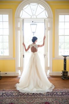 Wedding dress with open back and bow...I think this bottom is a little to full for me