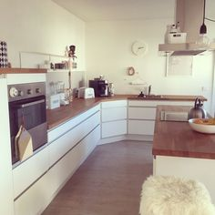 White with brown wood kitchen