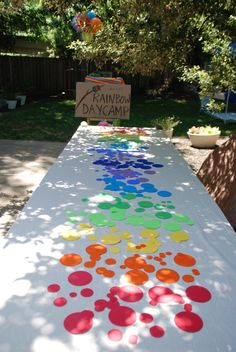 Rainbow table: Cute, inexpensive, and simple idea to brighten up a food or craft table at a rainbow birthday party, Wizard of Oz party, unicorn party, Carebears party, art / painting party, Candyland party, and more!