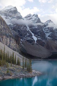 Moraine Lake is a glacially-fed lake in Banff National Park, 14 kilometres (8.7 mi) outside the Village of Lake Louise, Alberta, Canada.