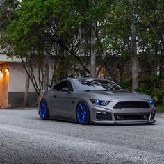 "Sinister What do you guys think of @brian_vossen's ROUSH inspired Mustang? Brian's Stang is equipped with the full #ROUSH R7 body kit, ROUSH quad-tip exhaust, 20"" @vossen VPS-306 wheels, and @accuair suspension!  Photo via: @kfletphotography @bagriders"