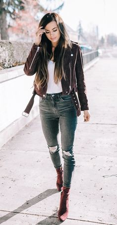 #winter #outfits  black jacket and blue denim distressed jeans