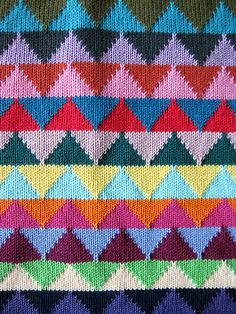 Triangle Station by Annie Larson, knit in 24 different colors.