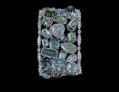 Christopher Designs Bracelet of green tourmalines and diamonds set in 18-karat white gold.