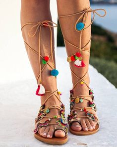 Tie up gladiator sandals, handmade to order Kirki  Gold leather sandals, decorated with an incredible exotic trim, pom pom, charms, coins and semi precious stones. Inspired by the Greek goddess, witch, nymph Kirki.  With those shoes you dont need any extra accessories.. Just wear a goddess dress and braid your hair like Greek goddesses did !! Everything is handsewn onto the shoes.  sizes available  EU____.....35......36......37......38.......39.......40......41.......42…