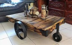For the repurposed wood pallet rustic look table, there is no need to invest time on painting the pallets. The small wheel is attached to the front end and 2 other wheels are attached to the sides. The table is a little bit above from the ground as only wheels are its support as legs.