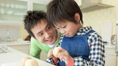 Father and Son Cookie and Talking in the Kitchen | Ways to Help Your Child Develop Coping Skills