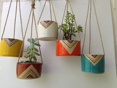 """These planters are about 3.75"""" tall with about the same width. The pieces are thrown on the wheel, hand-painted and fired several times to build up the printed surface. The pieces come in a range of colours. It's important to note that the soil level on these planters should be below the rope ends as the rope may breakdown if its continuously damp."""
