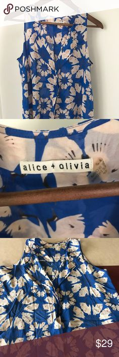 Alice & Olivia Floral Silk Tank Pretty light pink/blue silk floral tank. Size Small. 96% silk 4% spandex. It is on the sheer side, but a nude bra would be fine without a camisole underneath. High/low style. Excellent condition. Alice + Olivia Tops Tank Tops