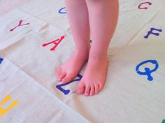 Easy #DIY Alphabet Stomp Mat! Fun game ideas: (1) Students stomp from letter to letter to spell their name or other simple words. (2) Shout out a letter and see if your students can stomp on the correct letter for letter recognition. (3) Cover up the letters with old game board pieces. Use a bean bag to toss onto the letters Fun practice for spelling lists for older kids. (4)  Grab a set of alphabet flashcards and match the letters on the mat. #preschool #efl #education (pinned by Super…