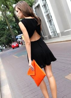 black dress. orange clutch